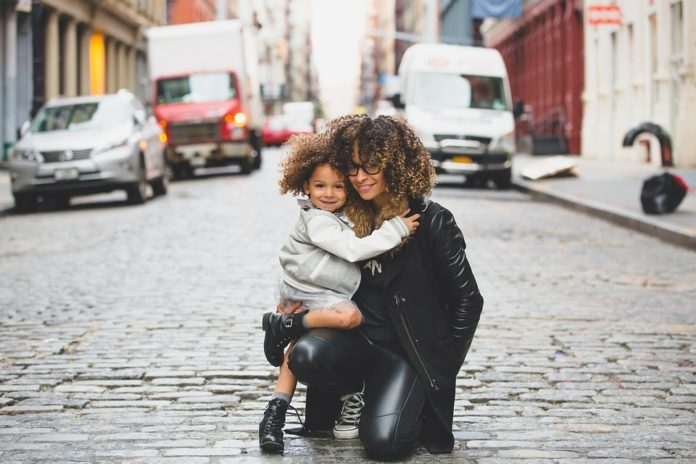 Mom and daughter in the street.