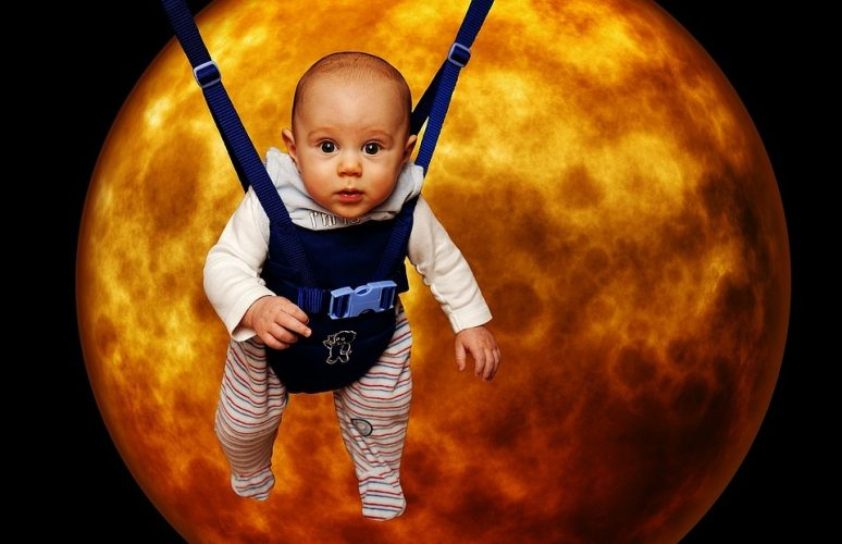Hilarious image of a baby in front of the moon.